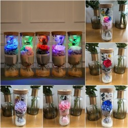 Bouquet of infinity roses in a glass vase with LED light